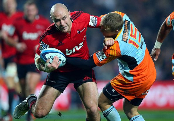 Willi Heinz of the Crusaders is tackled by Robbie Robinson of the Chiefs during the round 15 Super Rugby match between the Chiefs and the Crusaders at Waikato Stadium on May 24, 2013 in Hamilton, New Zealand.