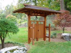 Cool Exterior In Wood Doors River Rock Wall Wood Pergola Roof And Outdoor Wood Gates For Your Tropical Entry Designs Image - Поиск в Google