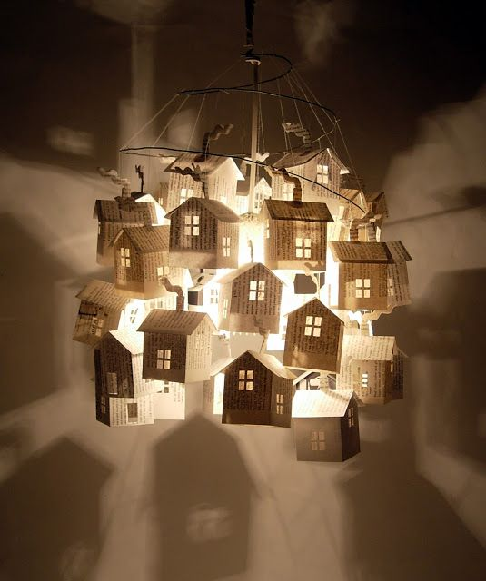 hutch studio: More on the Light Post.- pendant style light comprised of 33 paper houses made from vintage 50's cookbook pages.  They hang with thread from a spiraling wire support.