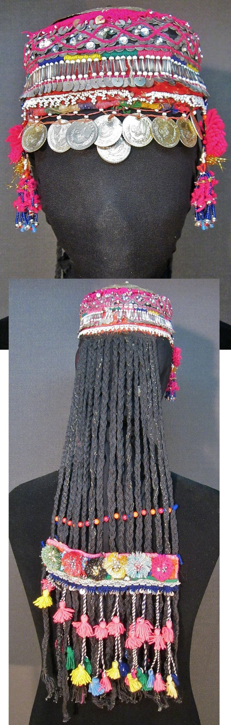 Front & rear of a traditional festive 'başlık' (headgear) from the Pomak villages near Biga (Çanakkale prov.), mid-20th c.  The 'imitation hair' (on the back) is not very elaborated, and used by betrothed or married girls/women, who cover their hat with a large headscarf.  Adorned with glass and plastic beads, metal (imitation) Ottoman coins, (cotton or orlon) tassels and pom-poms, and sequins (both metallic and mica).  (Inv.nr. ba$035 - Kavak Costume Collection - Antwerpen/Belgium).