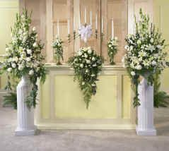 We could have flowers like this in the church.  I don't think we need the columns or flowers for the alter.  Just the 2 side arrangements.