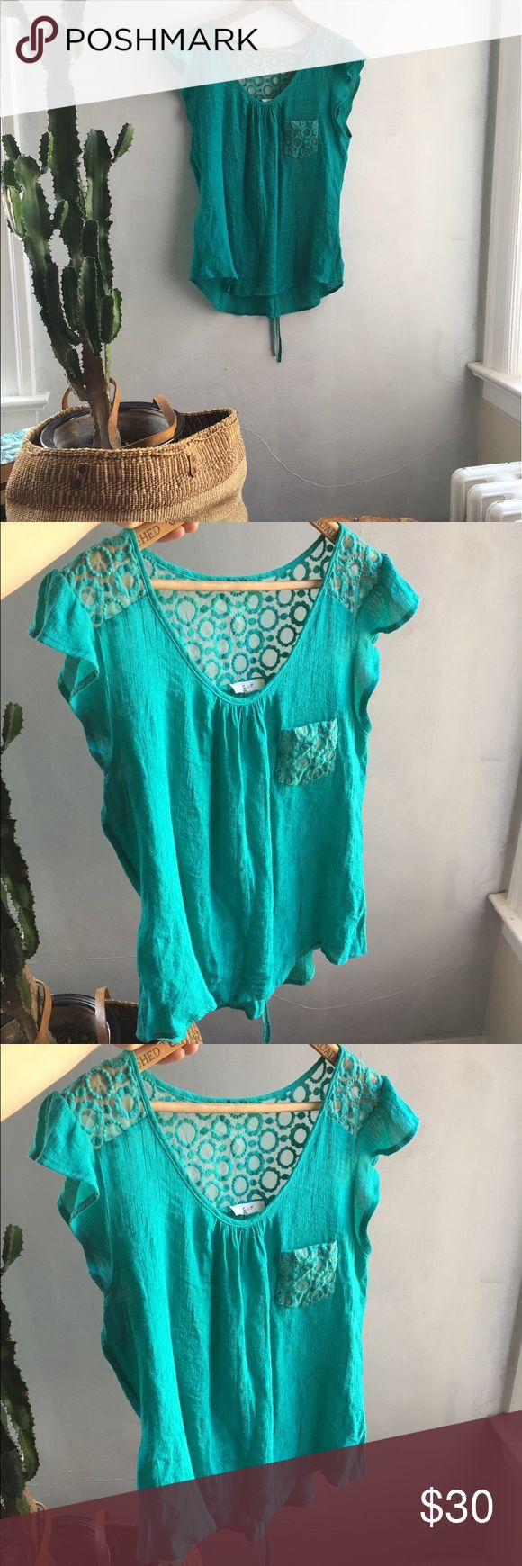 Cute Turquoise blouse Dang cute! A great blouse for summer parties and more! Size large but fits smalls and mediums fine. Sheer backing with a darling embroidered design. Hi-low cut and a draw string in the back to make this fitted to your liking ❤️ Tops Blouses