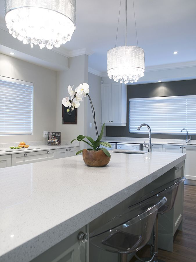 Nougat Caesarstone countertops and white cabinetry creates a restful, beautiful kitchen