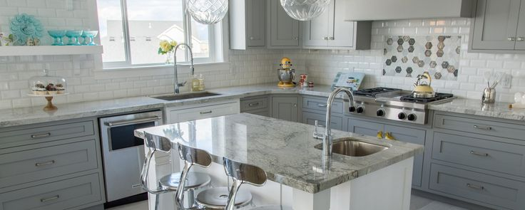 Stunning! A beautiful installation of our River White granite. #kitchens #granite #home https://arizonatile.com/en/products/granite/river-white