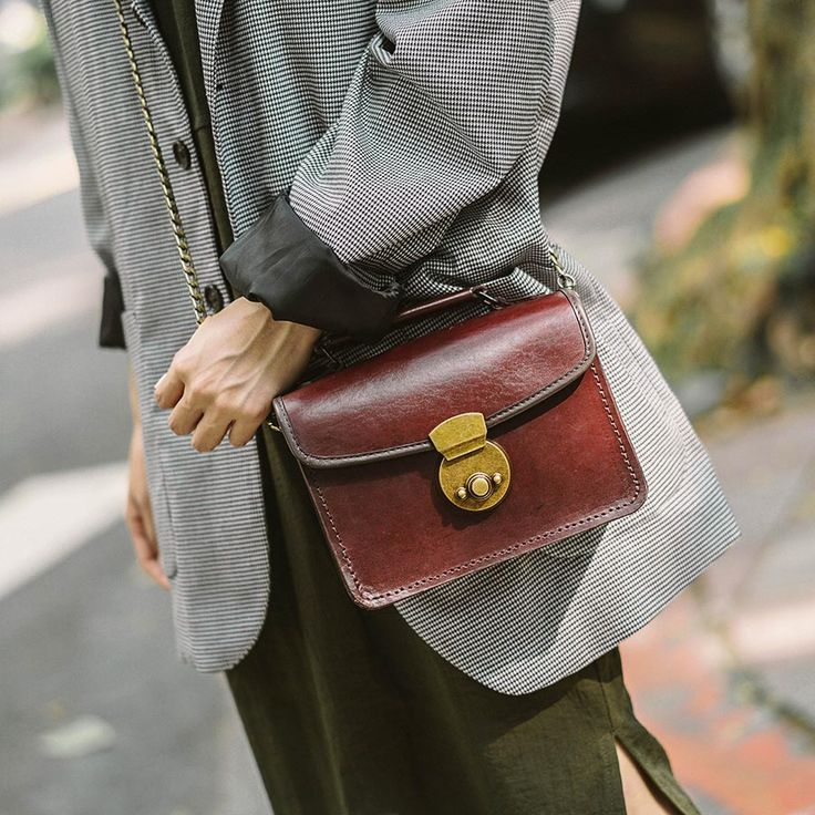The cute Manju leather satchel is handmade from quality brown natural leather and comes with an optional adjustable leather strap or chain