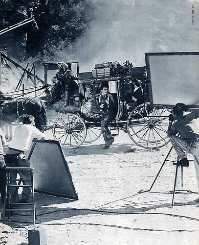 """John Wayne and Claire Trevor on the set of John Ford's """"Stagecoach"""", 1939"""