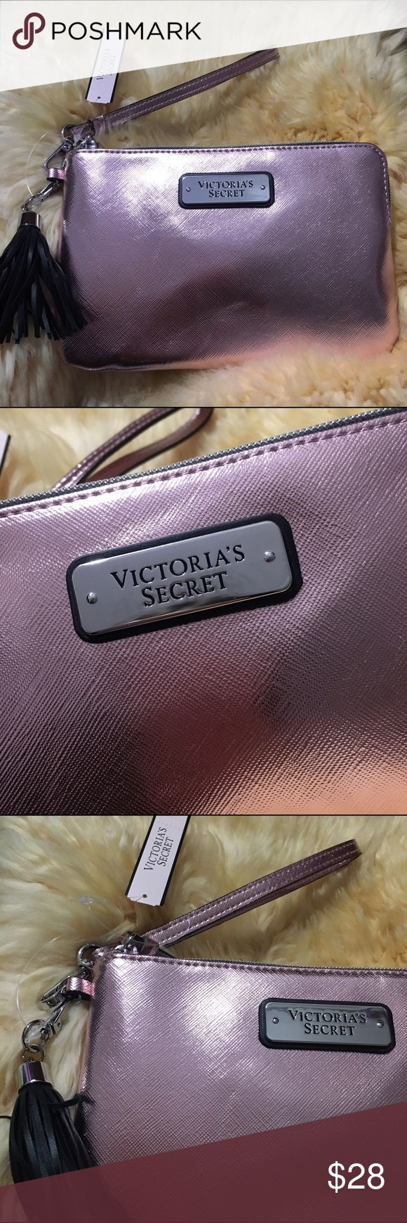 VS Pink Metallic Wristlet ❤️Brand new Victoria Secret Pink Metallic Wristlet❤️  Features: •Cute shredded leather charm •Wrist strap •Beautiful shiny Metallic pink color •Brand name displayed on metal plate Victoria's Secret Bags Clutches & Wristlets