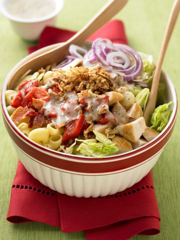 Chopped Salad - Shell macoroni or bow-tie pasta, iceberg lettuce, fresh baby spinach, cooked chicken, jar of roasted red pepper, red onion, bacon, Durkee fried onions, and poppy seed dressing.