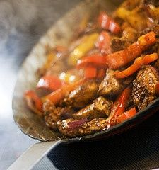 Chicken Fajitas - These turned out amazing. Used 2 green bell peppers 1 red, 3 limes, 2 lemons,  1 onion with thin cuts of chicken breast meat. Used lettuce wedges as the tortilla.