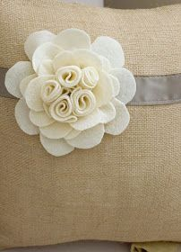 love the burlap and simple felt flower.