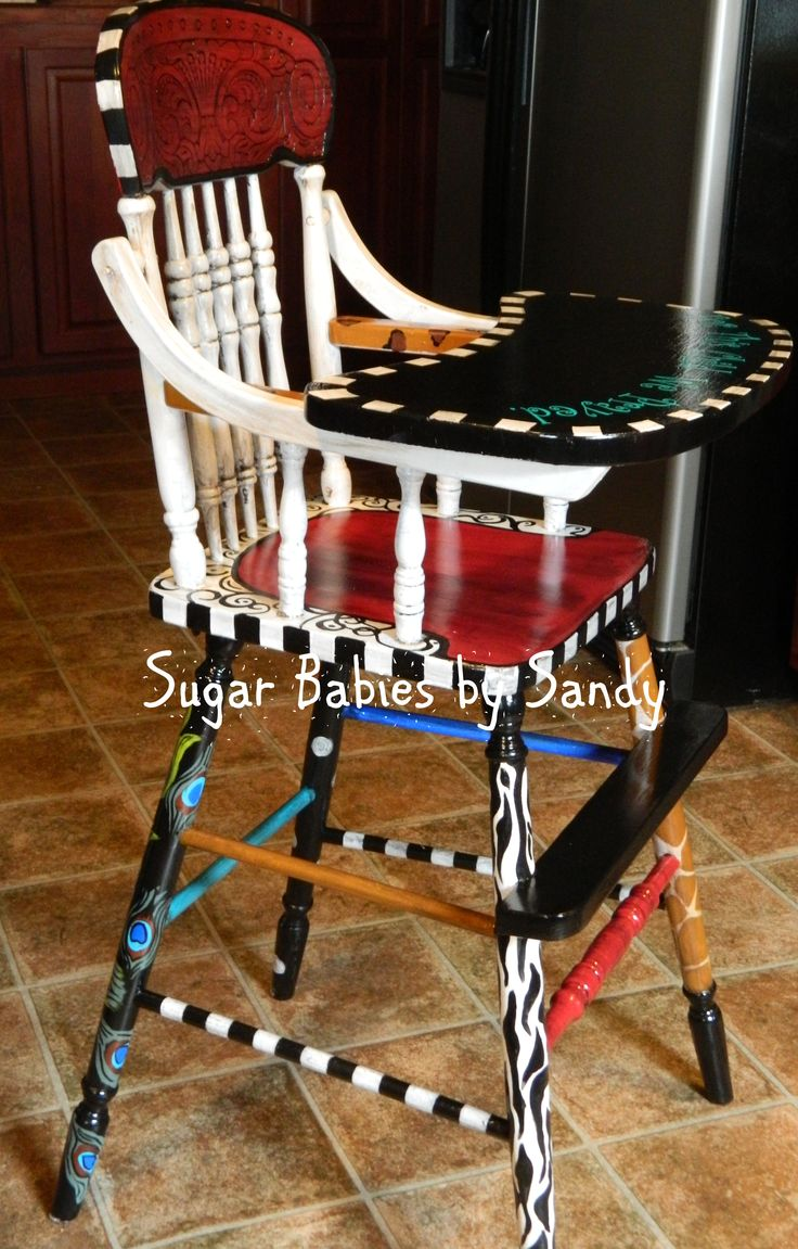 Hand painted, solid wood high chair $200. These sell for as much as $850 on etsy.
