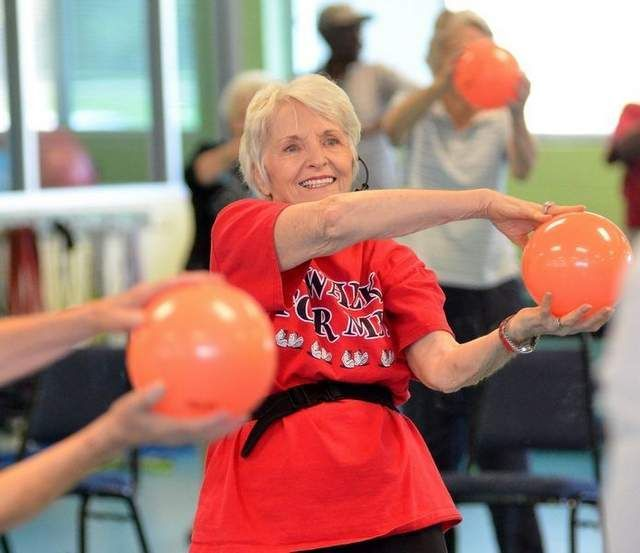 Exercise is Medicine. Instructor Freida McIntire leads seniors through a workout during the Silver Sneakers Senior Fitness Program at the Flowood YMCA in Flowood Wednesday.