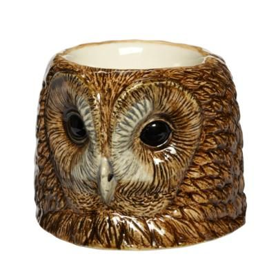 A unique, fine quality china egg cup in the design of an owl's head, making a great nature-inspired gift for any home. The cup has a nice weight and a heavy glaze.