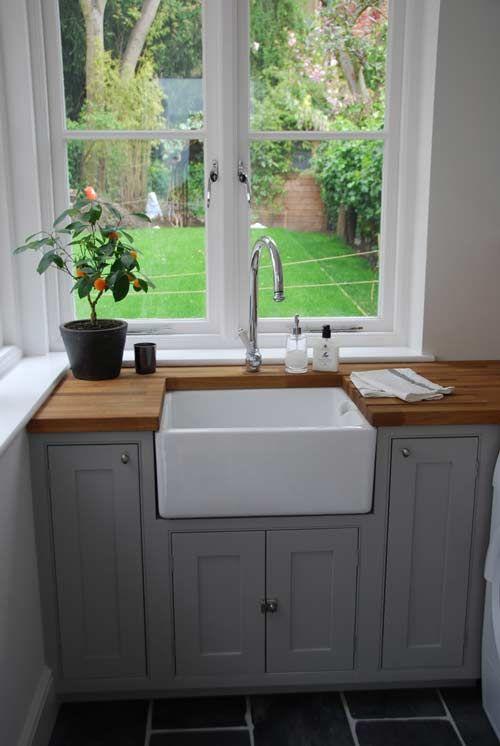 Butler sink, wooden worktop, grey painted units over looking a lovely little garden..