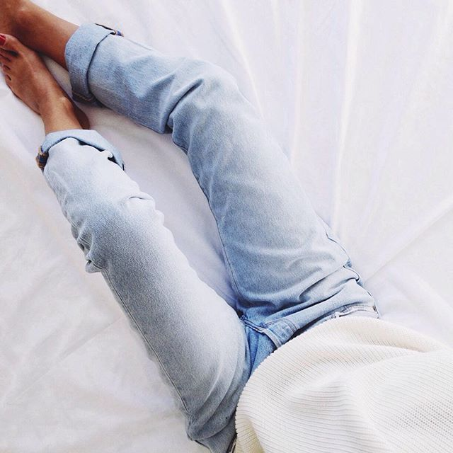 a pair of skinny light wash jeans.