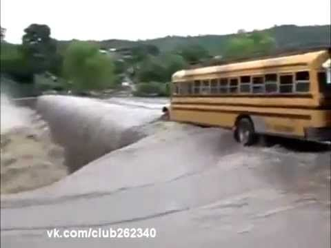"""Yellow School Bus packed with kids vs. high speed water flood - This makes me cringe.  That bus driver took the lives of every child on that bus and nearly threw them into certain death.  The bus only has to float a fraction of an inch to be swept off the """"bridge"""", and with that much water, there was a high likelyhood of it happening.  That driver needs some serious jail time."""