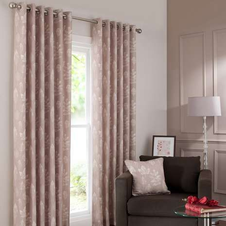 Finished in a natural champagne shade with subtle leaf patterning, these eyelet curtains are fully lined to regulate temperature and available in a range of wid...
