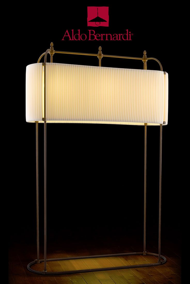 Can you imagine in your living room? Bora Bora by Aldo Bernardi: four stems oval antique brass mobile lighting fixture on oval base. Three lights and fabric shade is fully integrated into structure.