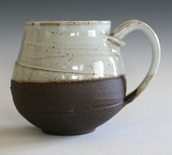 Simple but lovely cup, I like how a string of clay wraps around where the handle connects.