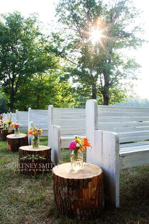 Love the white pews and tree stumps!!!