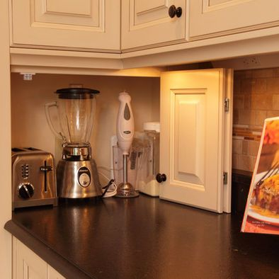 I like this design to hide appliances, it extends the cabinetry look instead of those roll up ones.