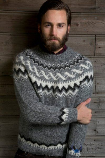 Grey hand knitted pullover with a dark grey heather and white pattern. Made with icelandic Plotulopi wool yarn.