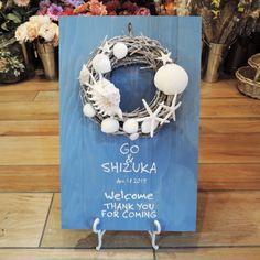 波の音が聞こえてきそう♡貝殻やヒトデを使ったリースがキュートなボード♪夏の結婚式にぴったりの青いウェルカムボードにまとめ一覧♡                                                                                                                                                      もっと見る