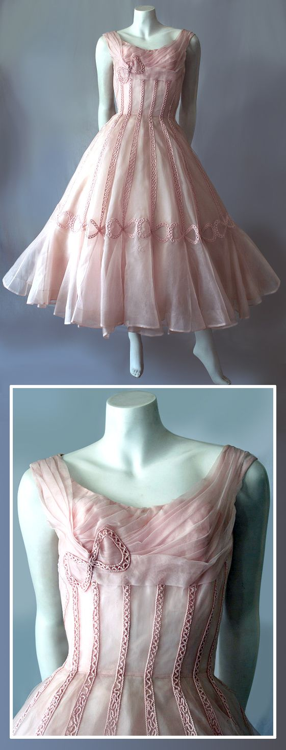 vintage 50s Ceil Chapman formal ballerina-length silk dress. Ceil Chapman was a top fashion designers during the 40s to 60s. She was reportedly Marilyn Monroe's favourite. Other clients included Grace kelly, Elizabeth Taylor and Deborah Kerr. Top quality in soft dusty pink silk organza. The fitted bodice is softly pleated over bust and shoulders finished with a silk corded bow. Has rows of vertical silk cord embroidery work to waistline extending down the skirt and ending in beautiful bows.