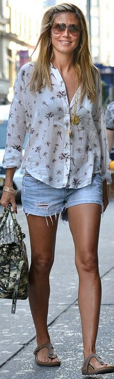 Who made  Heidi Klum's print button down top and tan flat sandals that she wore in New York?