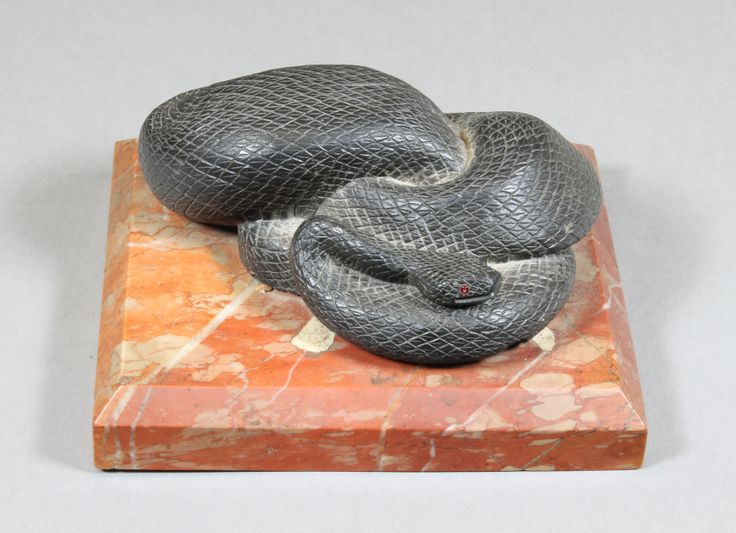A Victorian bronze and marble paperweight in the form of a coiled snake, est £80-120