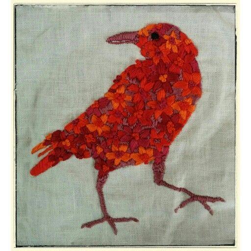 Red crow, purple beak.