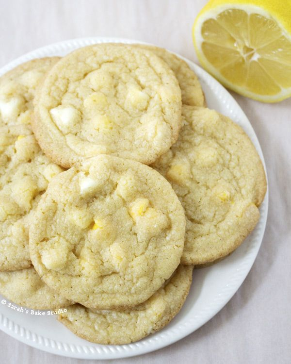 Lemon White Chocolate Chip Cookies – melt in your mouth white chocolate chips baked into a delicious lemon cake batter cookie; a match made in heaven.