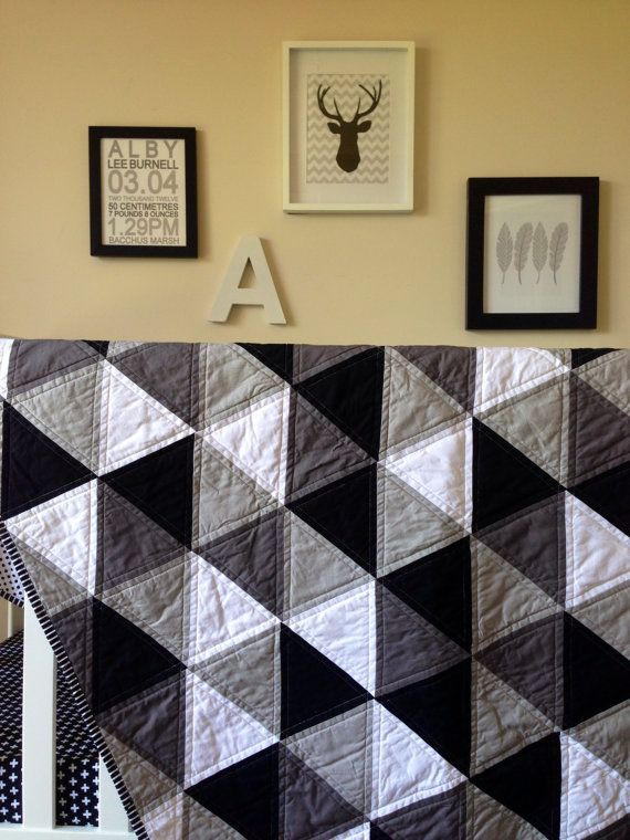 This monochrome triangle quilt will be a modern addition to any little ones room! This listing is for a custom made quilt which can be modified and changed to incorporate any colour scheme you require. This design is a very generous cot size which can be later used as a toddler throw or a big kid bed topper!    My quilts are made to be used and loved, take to the park, in the car, use as a playmat or at changing time on the go! Throw in the washing machine, and snuggle with your hub!    All…