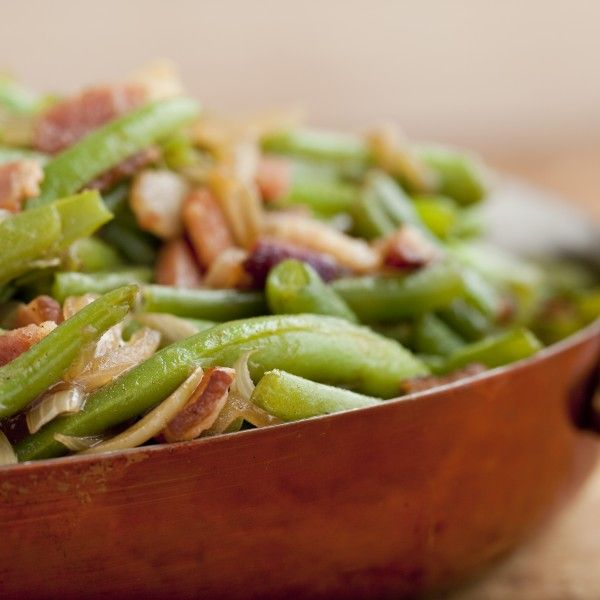 Why not kick up your green beans? Add some pancetta and caramelized onions - you won't be sorry.