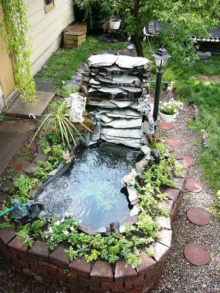 Waterfall fountian idea with a small yard pond this could for Mini fish pond design