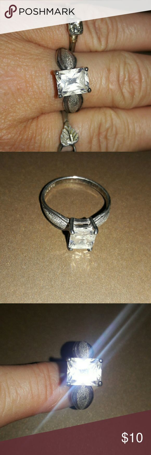 """Emerald cut """"diamond like"""" cz 925 sterling silver Vintage solitare emerald cut cz. Elegant band and stippled detail. The cz appears to be a 2+ karat cz or rhinestone. There are chips in the clear material around the top and bottom. This fit's an 8.5-9 size finger. Please ask any questions. Thanks! Vintage  Jewelry Rings"""