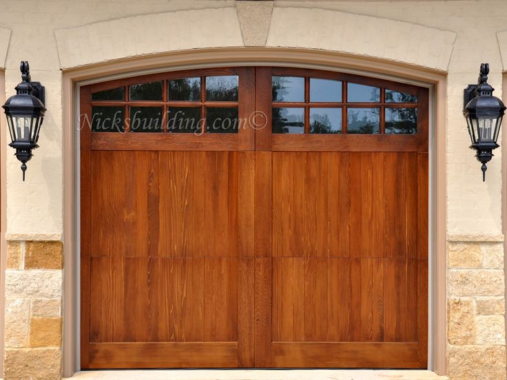 Arched top wood garage door garage door with glass from for 16x7 garage door with windows