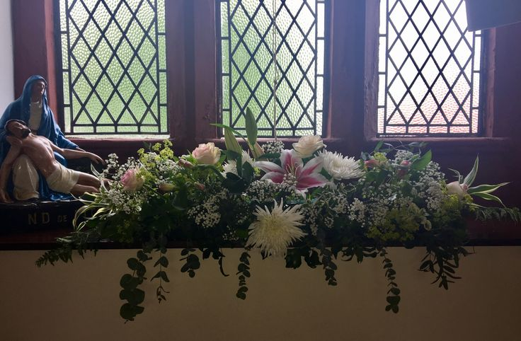 Long and low church window arrangement with stargazer lilies, white chrysanthemums, pink and white roses, alstroemerias, alchemilla and gypsophila