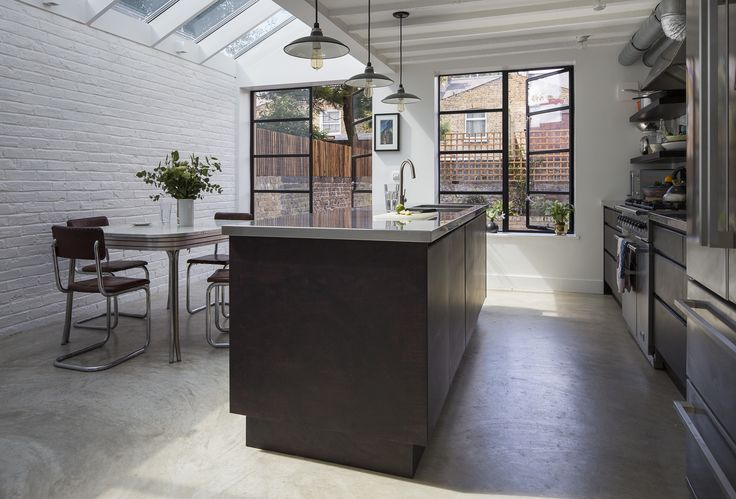 Our industrial inspired kitchen.  Photo by Tim Crocker