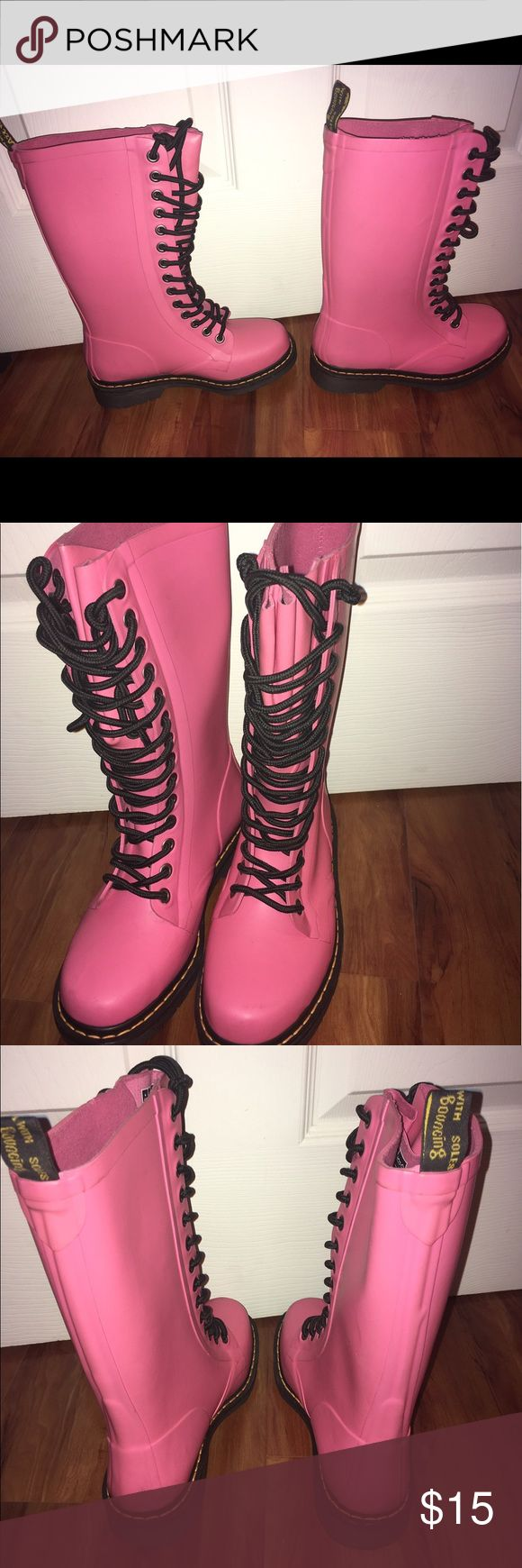 Doc Marten boots Rubber. Rain boot style. Bright pink. Size 6 fits up to 7. Never worn. Too tight for me. Lined. Chunky bottom. Doc Marten Shoes Winter & Rain Boots