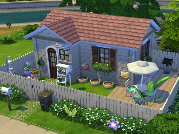 springtime is here, with its special colors ! what about a little cottage for your sims?  here is a very colorful and crazy house for your sims it has a little garden with some lovely decorations! the house has a special toilet !!  ..... you can find it at one of the pictures =)