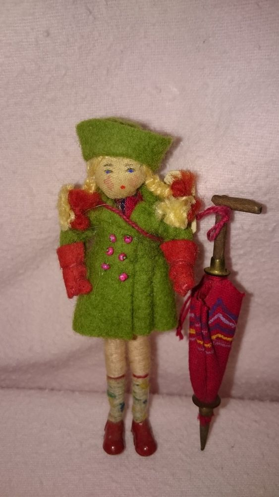 VINTAGE GRECON MINIATURE DOLLS HOUSE GIRL DOLL IN RAINCOAT WITH LABEL