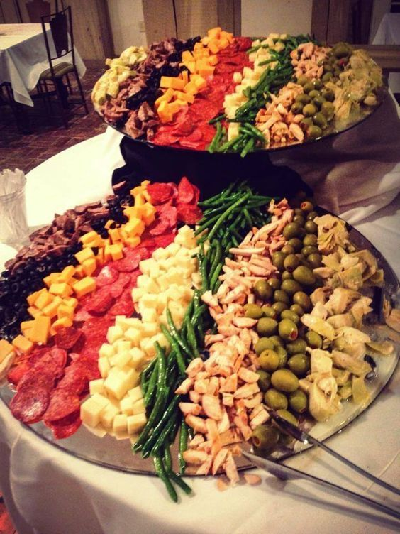 There's nothing like a giant fresh antipasta platter to bring two families together during a transitional cocktail hour between the wedding and reception.  For more about Nashville's rehearsal dinner location and wedding caterer, click the image above. Photo credit: Amerigo's Italian Restaurant Pinterest @amerigoitalian