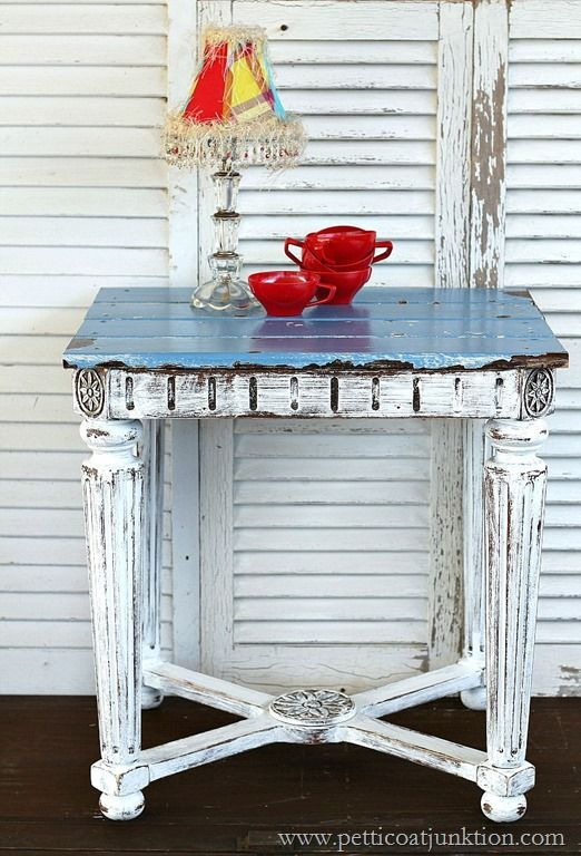 This table is made from reclaimed wood parts. The top of the table is reclaimed wood planks with chippy blue and white paint. The table base is highly detailed and distressed heavily.