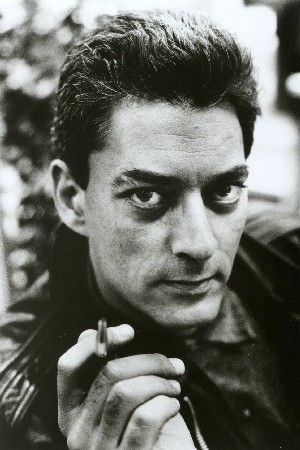 Paul Auster: His good looks are an obvious attraction but what adds to it is him holding a pen, not a cigarette. Now that is HOT! ;)