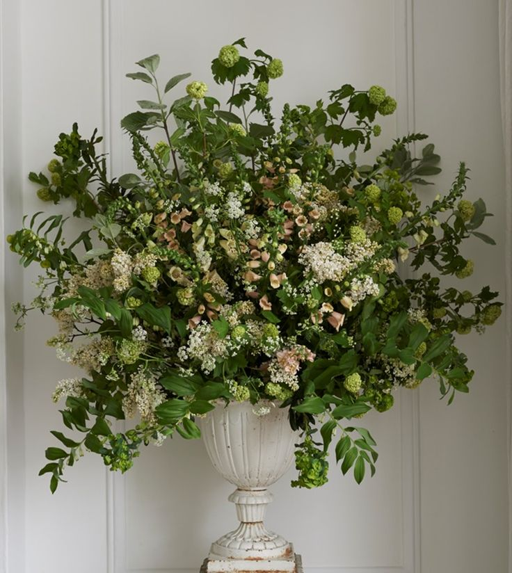 The feel of the flower urns will be like this but packed full with colour. Loose and natural and WOW!! vintage wedding flowers by vic brotherson