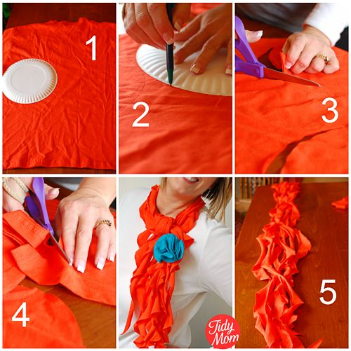 lay t-shirt out flat (make sure you can get 8-12 circles)  Use paper plate to trace 8-12 circles on t-shirt (4-6 on each side of the shirt)  cut out circles  cut each fabric circle into a spiral (*see how to do this in the video)  stretch each piece of fabric and lay all pieces together  tie around your neck and place a pretty flower pin to dress it up!