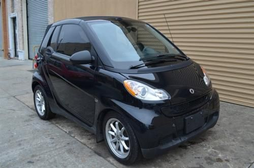 # 18308 This 2008 smart Fortwo 2dr Passion Convertible features a 1.0L L3 PFI DOHC 12V 4cyl engine. It is equipped with a 4 Speed Automatic transmission. The vehicle is Black with a Black interior. It is offered As-Is, not covered by a warranty. - You're viewing a beautiful 2008 Mercedes Smart Car with only 10,855 miles. It's a very sharp car in excellent condition. It's black with Black leather interior and a convertible top.