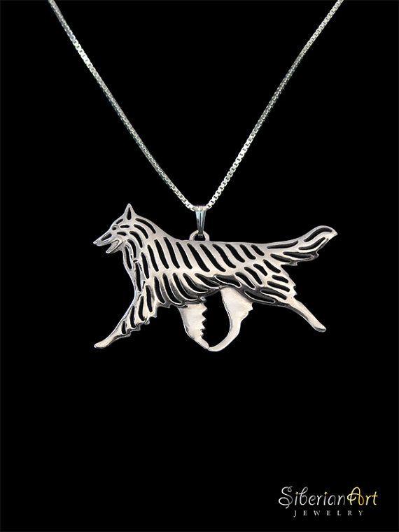Un ciondolo unico movimento belga & collana, progettato da Amit Eshel.  Questo delicato gioielli manterrà il vostro migliore compagno vicino