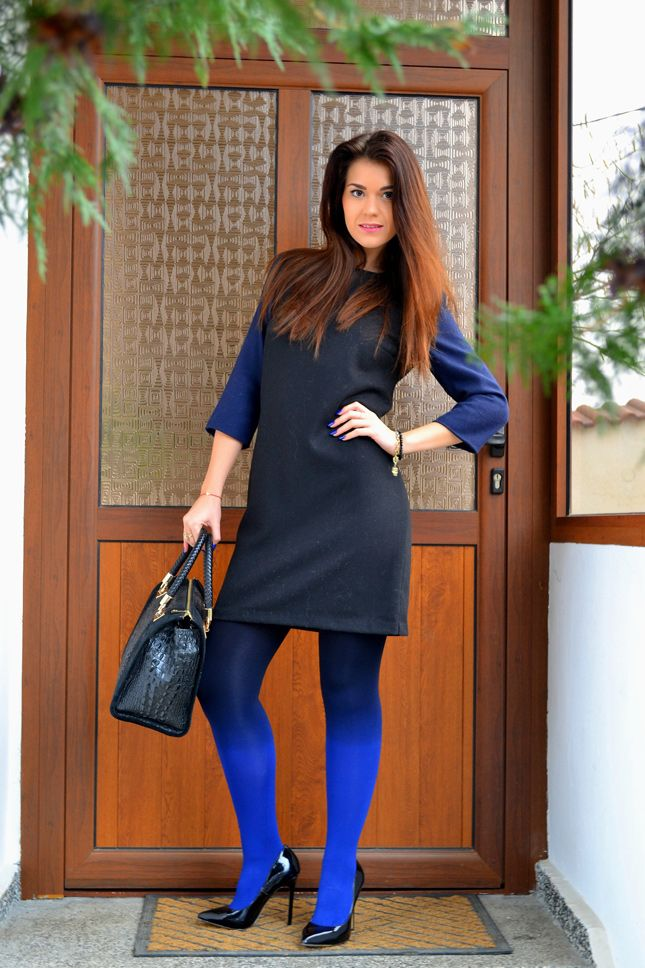 Shop this look on Lookastic:  http://lookastic.com/women/looks/black-and-blue-shift-dress-blue-tights-black-tote-bag-black-pumps/6548  — Black and Blue Shift Dress  — Blue Tights  — Black Snake Leather Tote Bag  — Black Leather Pumps